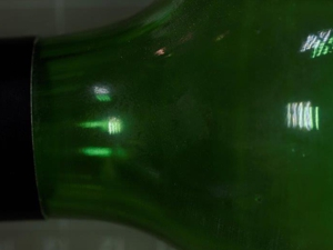 fingerprint on glass bottle
